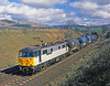 During the brief period when 7 86/2s were re-geared for freight work, 86505 rolls south past cloud dappled Lambrigg with the mid-day mixed freight on 28th March 1989.