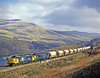 Running hours(about 20) out of course consecutively numbered pair 37264 and 37263 fill the Lune Gorge with reverberation as they are worked flat out to gain as much momentum as possible for the climb to Shap Summit about 1 ½ miles ahead. 6th April 1988.