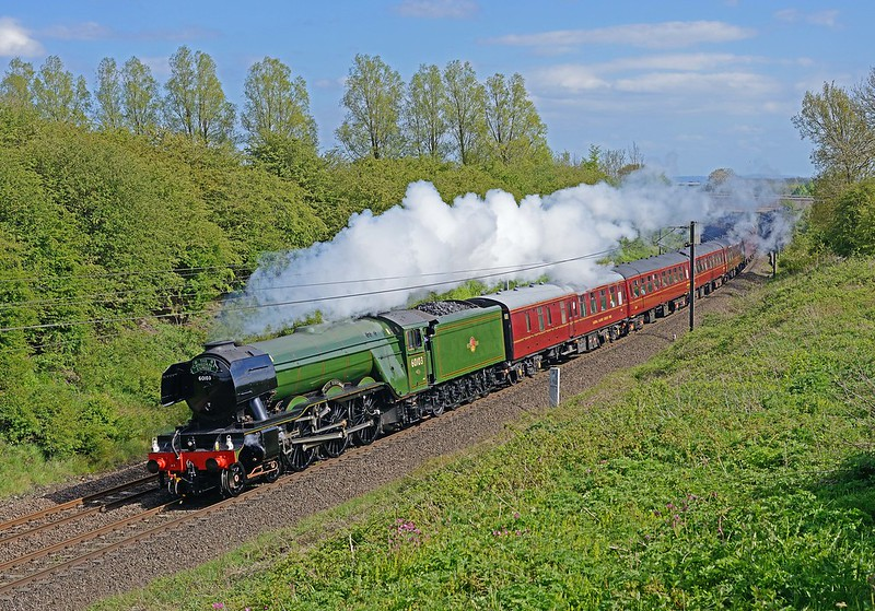 """60103 FLYING SCOTSMAN, having passed Darlington at speed is running at Aycliffe very close behind a VTEC service whose 91 was accelerating away from its Darlington stop on.14/5/16. <br /> A """"Frequently used location chosen to take advantage of protection from strong north east wind.""""<br /> 14- 5-16"""