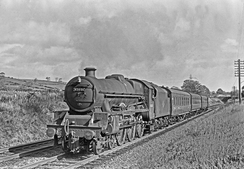 45606 ,July 1963.  Taken between Ulverston and Pennington .<br /> The 4 wheeled van will restrict it to 50mph, and it's actually fitted with a speedo(attached to the rear driving wheel). It's called FALKLAND ISLANDS!