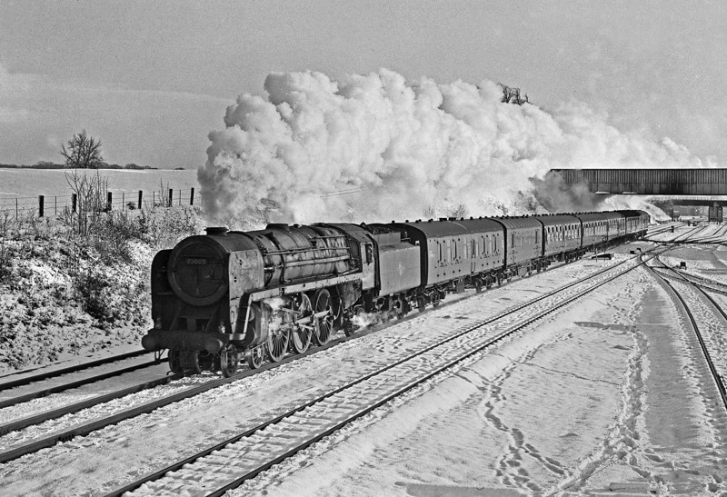 """It's almost possible to imagine the passengers on this train, the 09.25 Crewe to Perth, who had been on it south of Carlisle, saying"""" Ooh I think some heat is getting through now"""" as 70005 forges north on quite a long run to Perth. As booked, it will have taken over from a Crewe based Class 40 diesel at Carlisle and the passengers will now have a warm and comfortable continuation of their journey. 1st November 1965. The Waverley Route was blocked by snow but the freights were cancelled and the diesel-hauled passengers diverted by the shorter and quicker WCML via Carstairs."""