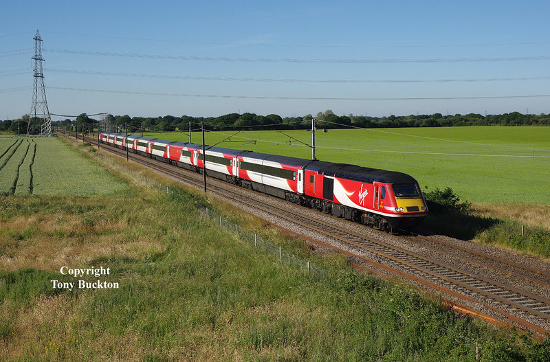With the operation of East Coast Mainline services being taken back into public ownership, the Virgin livery of the current stock will soon be obsolete - 43314 leads the 1Y90 18:02 York - Kings Cross service as it approaches Joan Croft Junction at 18:27 on Wednesday 27th June 2018.