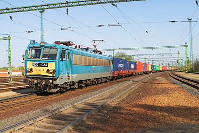 630 034 'Budapest-Ferencváros' heads eat through Tatabánya with a long Intermodal train. Thursday 25th April 2013.