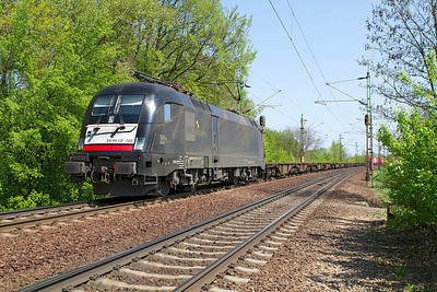 MRCE Dispolok's Taurus ES 64 U2-062 heads westbound with a partially loaded Intermodal at Szöny. Thursday 25th April 2013.