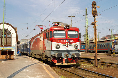 CFR 477-895 heads away from Budapest-Keleti heading the return through working, train 373 to Bucharest, Romania. Monday 22nd April 2013.