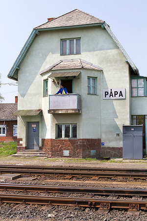 The signalman at Pápa watches a departure from his signalbox balcony. Monday 22nd April 2013.