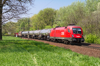 OBB 1116 014 allocated to RCH-MAV Cargo brings a mixed freight eastbound at Szöny. Thursday 25th April 2013.
