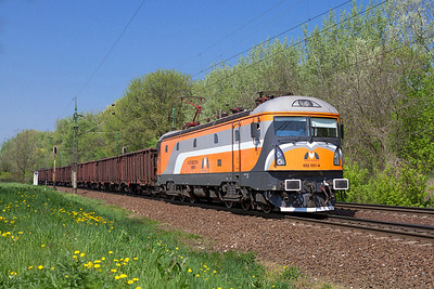 Magyar Maganvasut's (MMV) 602 001 heads east past Szöny with loaded coal. Thursday 25th April 2013. Softtronic prototype locomotive rebuilt from CFR 478-002 with new body design and equipment.
