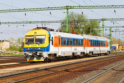Class 5141 BVmot 001 'Varga Lásió' arrives at Tatabánya forming the 09.05 Oroslány to Tatabánya. This unit operates an hourly shuttle service between these two locations. The unit was originally 4 cars and now reduced to 2 cars and operating in an InterCity livery.  Thursday 25th April 2013.