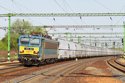 630 021 passes Tatabánya eastbound with Rail Cargo Austria hoppers. Thursday 25th April 2013.