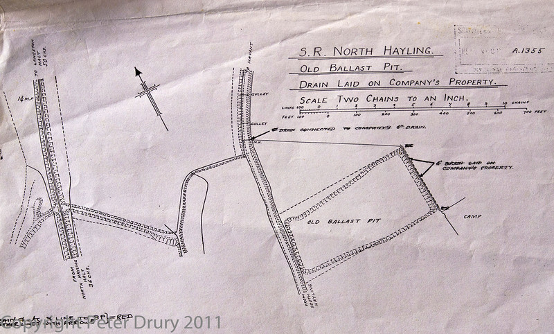 25 Oct 2011 Circa 1939 SR Sketch showing the old ballast pit used by the railway.<br /> This is a sketch of the area showing embankments leading to the railway bridge and the road bridge. The road that connected the ballast pit to the railway was removed by the time of this sketch but cut directly over the field to form a straight alignment with the track leading from the railway.<br /> The abandoned (1866) railway embankment can also be seen on the extreme left.