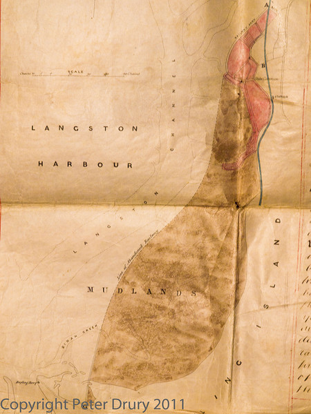 """27 Oct 2011 Map of the Hayling Billy railway from a legal document dated 1873.<br /> To avoid having to buy land on Hayling Island for the construction of the railway, the 1860 Act of Parliament authorised the building of the railway on an embankment over the mud flats in Langstone Harbour. This was abandoned in 1866 and the line was re-routed inland. This map shows the abandoned railway alignment (as dashed lines) to the left of the brown and red shaded areas and the new alignment marked in blue.<br /> For more information, read the article on our HB50 website here > <a href=""""http://www.haylingbilly50.co.uk/node/74"""">http://www.haylingbilly50.co.uk/node/74</a>"""">"""
