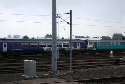 156469 in Bishop Auckland vinyls and a Class 142, 142087.