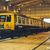 303062 inside Glasgow Shields Road depot in 1982