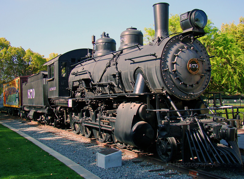 The City of Santa Fe Springs owes a lot to the presence of two railroad lines. The railroad exhibit tells the story of the City's railroad history through the careful restoration of the Santa Fe Railway depot, tracks and signals. At the center of this exhibit sits the No. 870, a restored steam locomotive, and its tender, along with a refrigerated boxcar and caboose. Although no longer operative, this ATSF engine reminds visitors that the little town of Fulton Wells was so pleased to have a railroad line built through here in the 1870s that it changed its name to Santa Fe Springs. The exhibit includes two meeting rooms, a picnic area and a rose garden.