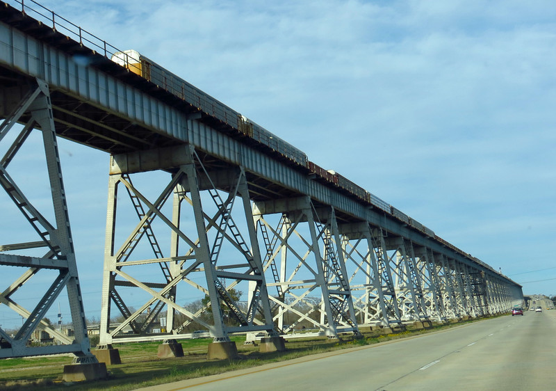 Mixed freight climbing Huey P. Long bridge over the Mississippi River, heading into New Orleans.