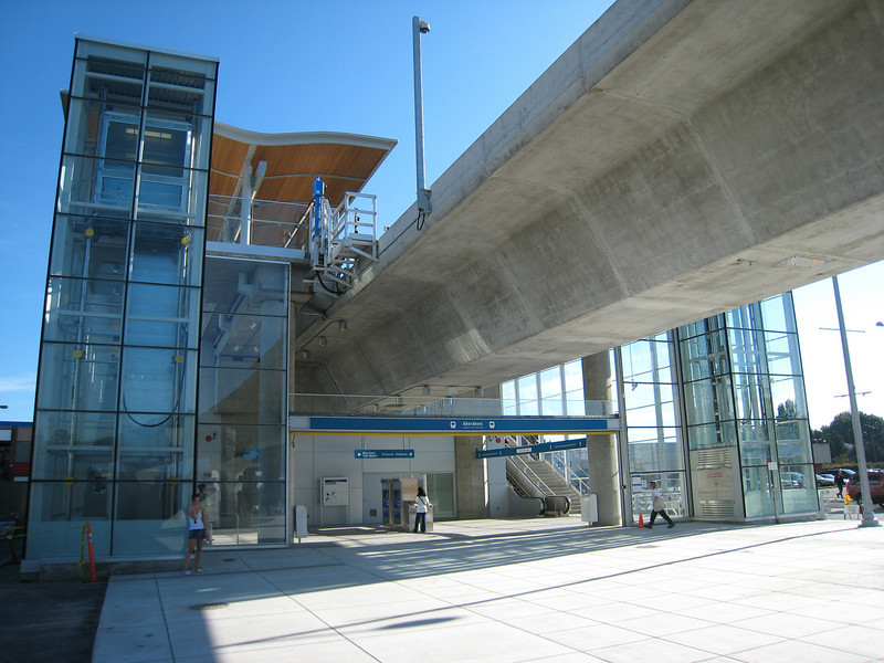 The station concourse at Aberdeen Station is at ground level.  Each elevated station has a similar layout: passengers enter directly beneath the guideway and then ascend escalators to the left or right depending which direction they want to travel.