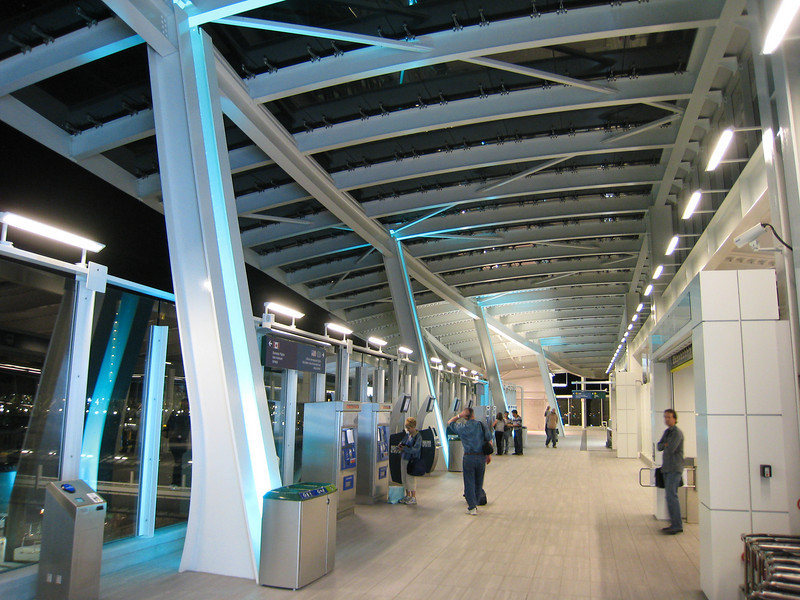 The ticketing area of YVR-Airport Station at night.  The entrance to the platform is at right.