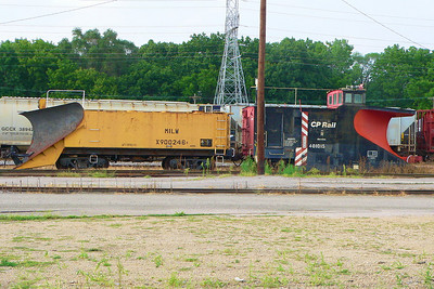 MILW snowplow X900246 and CP Rail snowplow 401015 in the CP yard at Portage, WI.