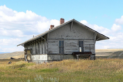 Milwaukee Road depot at Ringling, MT. The town was named for John Ringling of circus fame. The Ringlings owned ranch land in the area. He served as President of the White Sulphur Springs and Yellowstone Park Railway which ran between Ringling and White Sulphur Springs, MT.
