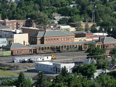 """Historic Northern Pacific Livingston (MT) Depot. This used to be the """"Gateway to Yellowstone."""" From Livingston, passengers would board a train which ran South to the Park entrance at Gardiner, MT. The depot is the large building in the center. The smaller buildings are the beanery on the left and the baggage building on the right."""