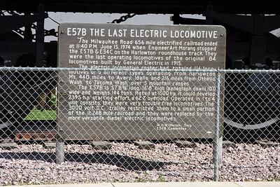 Sign describing the Milwaukee Road GE E57B electric locomotive on display at Harlowton, Mt.