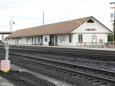 """GN depot at Shelby, MT. In use as Amtrak stop for """"Empire Builder""""."""