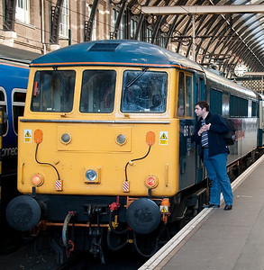 Here's yours truly pictured at Kings Cross inspecting West Coast thoroughbred 86101 Sir William Stanier before taking up position for a trip onboard 1G03 09:34 Kings Cross to Doncaster Hull Trains service 12/4/2008. This picture appeared on one of the Phoenix Railway Photographic Circle online gallery's a few years ago and was spotted by several friends of mine.<br /> Picture courtesy of Steve Arthur.