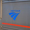 Once upon a time, Amtrak's sleeping cars carried names.  Some still do, and you can see the outline of where the name used to be above and below the Amtrak logo.