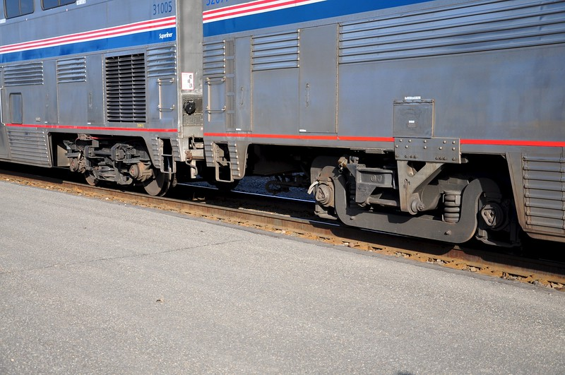 On the left is a Superliner I, on the right are the newer designed trucks that the Superliner II cars ride on.