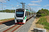 TransPerth B series emu 454 slows for the stop at  Warnbro. This the line from Mandurah and the service is heading for Perth.