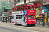 Tram 15 is seen at the Lau Sin Street stop heading for Happy Valley. Note the Bamboo scaffolding a common sight in HK.