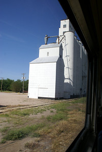 Grain elevator at Maize seen from train