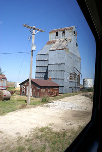 Passing abandoned grain elevator at Elmer, KS