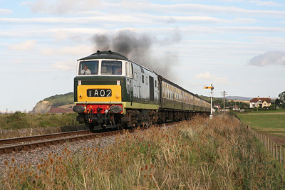 The secondman seems to be enjoying the sound as the driver opens up D7017 on departure from Blue Anchor with the 16.45 Bishops Lydeard - Minehead train during the WSR Mixed Traction gala. 1/9/12