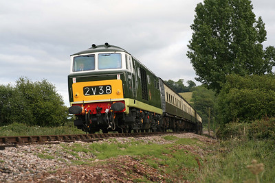 D7017 in charge of the last train to Minehead, the 18.00 from Bishops Lydeard, on the approach to Williton. 10/6/11