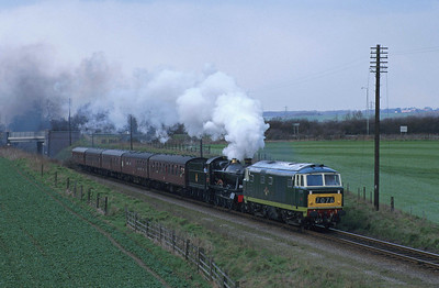 D7076 doubleheads with 6990 'Witherslack Hall' on the GCR at Woodthorpe Road bridge. 31/3/96