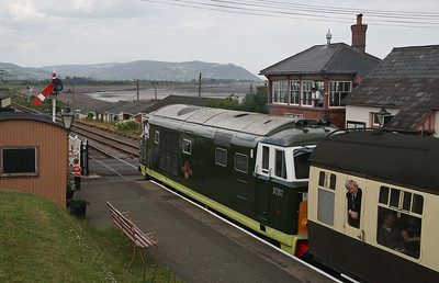 Staff lean out of their respective windows as D7017 waits to leave Blue Anchor for Minehead. 13/6/10