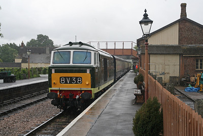 Fine weather was at a premium during the WSR's Diesel Gala in 2011. In this scene, D7017 is arriving at Williton from Bishops Lydeard and most onlookers are under cover. 10/6/11