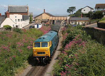 Where the West Somerset Railway first meets the sea, D7017 drifts through Watchet with a non-stopper to Minehead. 14/6/09
