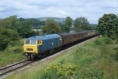 A visitor to the East Lancashire Railway, D7017 runs through Irwell Vale with a train from Rawtenstall to Bury during a Diesel Gala.
