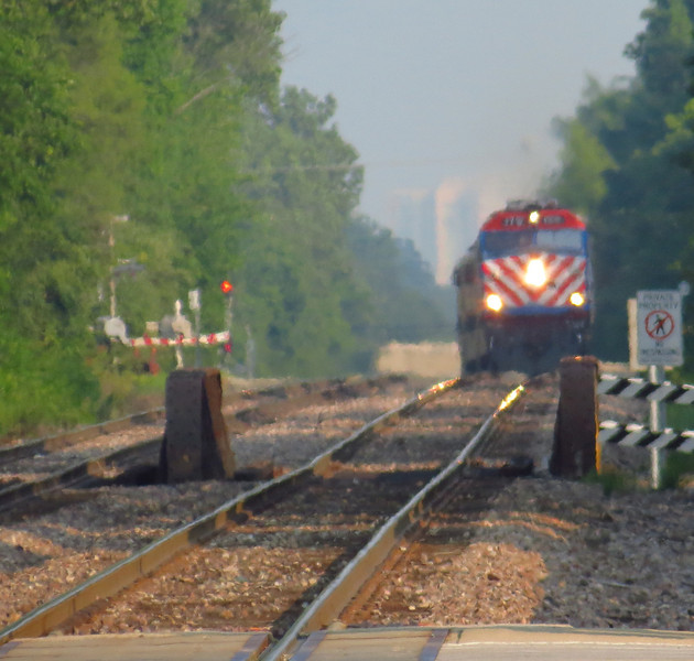 Same train, with an F40 leading.  The zoom setting allows the bow of the stick rail to be seen.