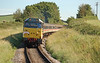 31454 has charge of the short lived Butlins Express service from Bristol to Minehead, seen here approaching Doniford halt on the WSR 24/08/2007.