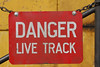 A warning sign on a CP ballast cleaner, Delanson, NY.