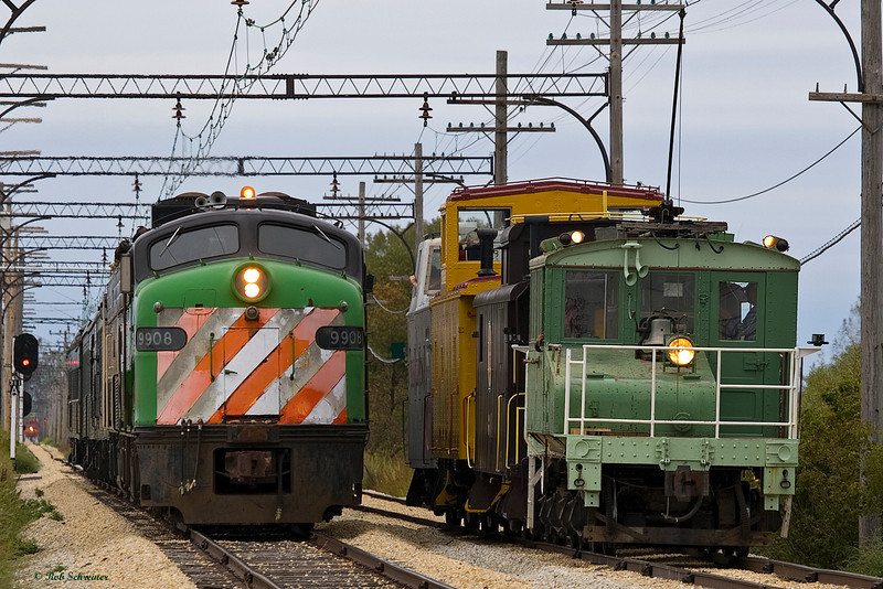 The morning version of the caboose train, passes the BN lead coach train in the siding.