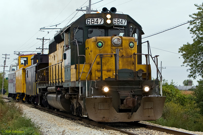 The C&NW duce leads the caboose train.