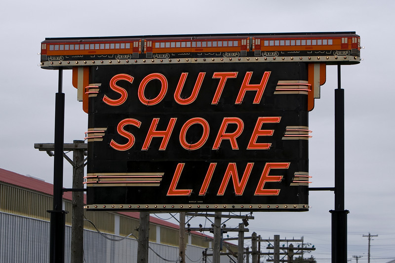 The twinkle and neon of the old South Shore sign.