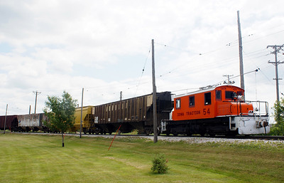 Iowa Traction #54 parked on the IC&E interchange with a cut of cars for AGP.