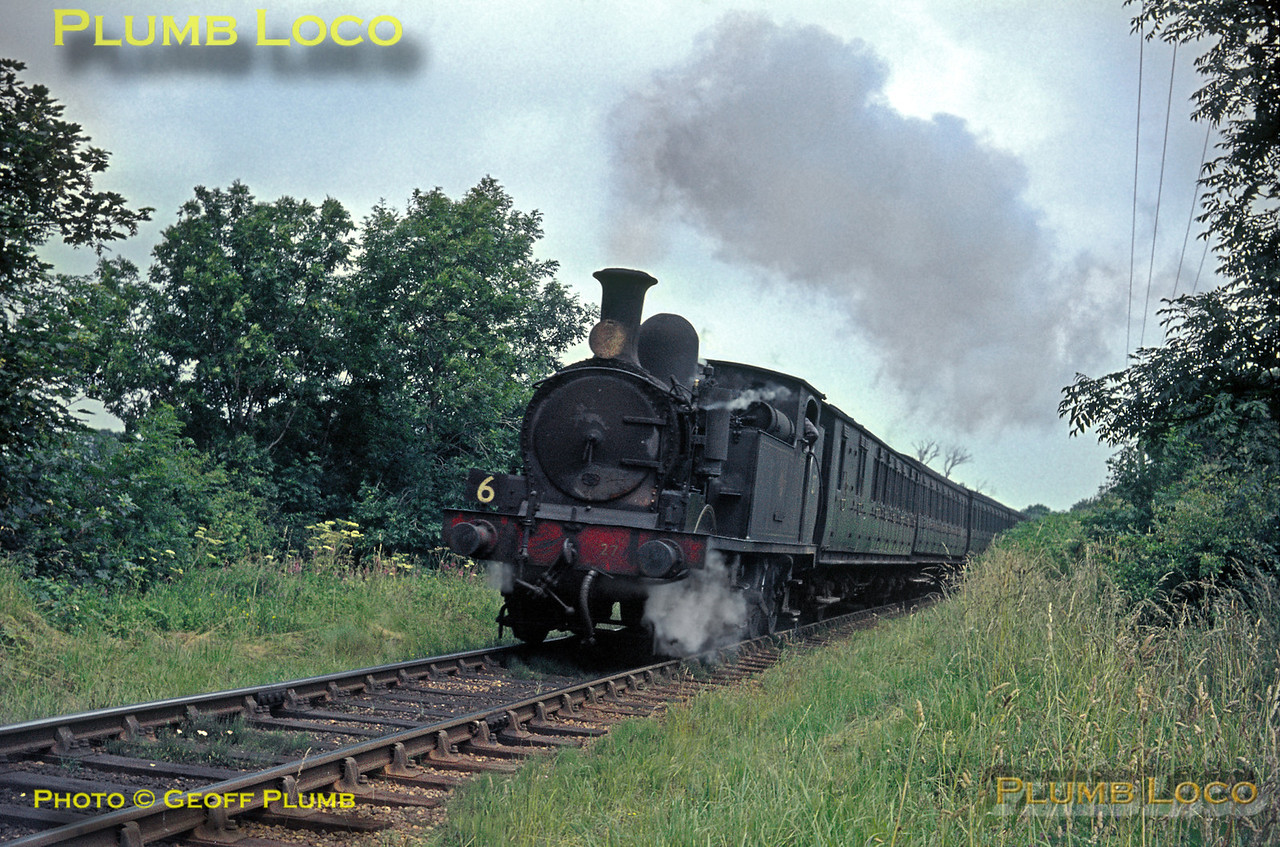 "O2 class 0-4-4T No. W27 ""Merstone"" is working duty No. 6 which includes this train, the 12:05 from Ryde Pier Head to Ventnor, approaching its next stop at Wroxall on Wednesday 21st July 1965. Slide No. 1456."