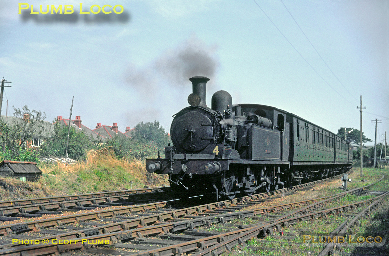"""O2 No. W21 """"Sandown"""" is drifting into Shanklin station with the 11:28 train from Ryde Pier Head to Ventnor on Wednesday 2nd September 1964. Slide No. 1004."""